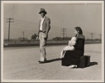 Young family, penniless, hitchhiking on U.S. Highway 99, California. The father, twenty-four, and the mother, seventeen, came from Winston-Salem, North Carolina, early in 1935. Their baby was born in the Imperial Valley, California, where they were working as field laborers
