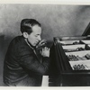 Henry Cowell playing the piano
