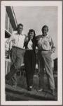 Chester Kallman standing next to Rhoda Jaffe and W. H. Auden, taken on Fire Island