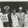 """Servicemen and ladies hold up newspapers announcing """"Victory in Japan"""""""