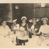 "Ada ""Bricktop"" Smith (far left) seated with ladies at table."