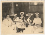 """Ada """"Bricktop"""" Smith (far left) seated at table with other women"""