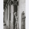 Room for White: Elderly Caucasian woman standing in doorway of racially segregated boarding house