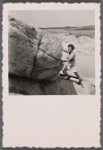 Jean Garrigue pushing huge boulder up hill