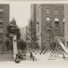 Young children playing in playground at the Dunbar Apartments, Harlem, New York City, ca. 1920s