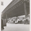 Street vendors underneath the elevated train line near the corner of West 145th Street and Ninth Avenue, Harlem, New York, 1939