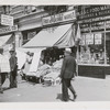 Lenox Fruit & Vegetable Market being picketed by labor union supporter, Harlem, New York City, 1939