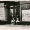 Sidewalk sitters. Two women sitting in doorway of empty storefront that is being offered for rent, Harlem, New York City, ca. 1930s