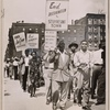 Demonstrators protesting housing discrimination in Stuyvesant Town among the pickets at the opening ceremony of new St. Nicholas housing complex on Eighth Avenue in Harlem, New York City, 1950