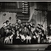 Stanley Prager [with glasses, kneeling 4th from left] Thelma Pelish [grey suit, center] and ensemble in the stage production of The Pajama Game