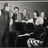 Donald Wolfit, Eugene Roche, John Sharp, Hazel Douglas, Marjorie Rhodes, and unidentified woman playing piano in the stage production All in Good Time