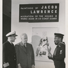 """Artist Jacob Lawrence, with United States Coast Guard Captain Joe S. Rosenthal and photographer Carl Van Vechten, at his painting exhibition, """"Paintings by Jacob Lawrence: Migration of the Negro & Works Made in the U.S. Coast Guard,"""" in New York City, 1941.]"""