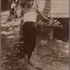 Young woman with basket and bunch of fruit.
