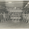 Chorus girls and other performers, as well as a stage prop resembling a railroad passenger car, at Connie's Inn, in Harlem, New York City, ca. 1920s.