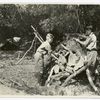 Summer vacation camp, 1924 : close up of scouts building a shelter.