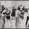 Choreographer Agnes de Mille rehearsing dancers for the stage production 110 in the Shade