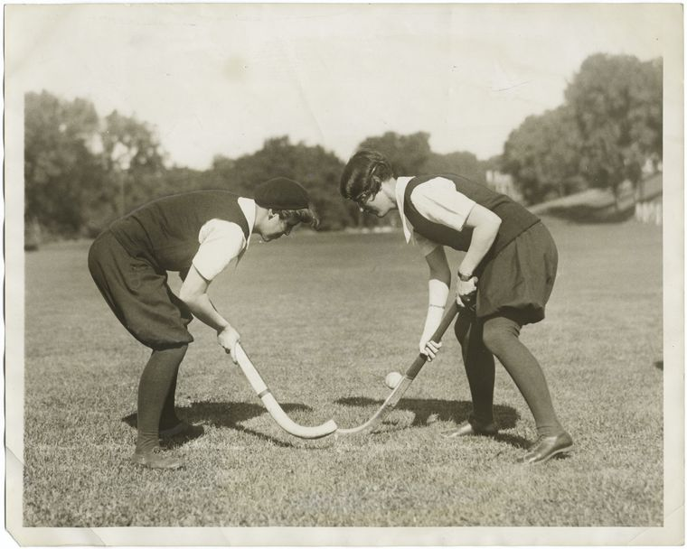 Bully! : the start of a hockey game played by Agnes Rodgers (left) of Philadephia, and Marion Neilson of Darien, Conn., two students at Smith College, Northampton, Mass.
