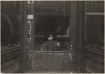 Girl at door, New York City