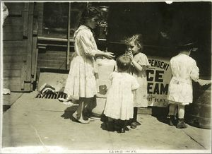 Four children on a sidewalk, New York City