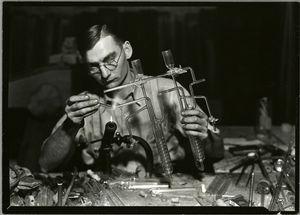 Glass worker making laboratory... Digital ID: 416525. New York Public Library