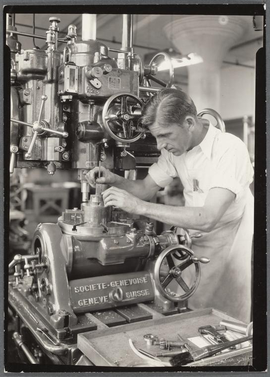 Precision mechanic using depth gauge on a metal boring