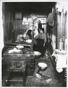 A rear tenement room, New York Digital ID: 416558. New York Public Library
