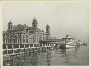Immigrant Station, Ellis Island, with ferry docked at adjacent pier.