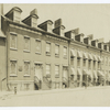 Block of five houses on Charlton St. near corner of Varick St., N.Y.