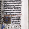 Opening of French text, border decoration, large initial, rubric.