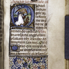 Historiated initial with the Archangel Michael; partial border, initial and rubrics.