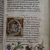 Historiated initial of Entry into Jerusalem.  Floral border, rubric, placemarkers.