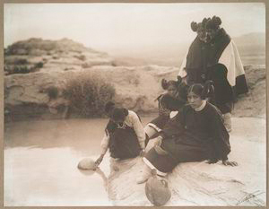 Hopi girls at the well.