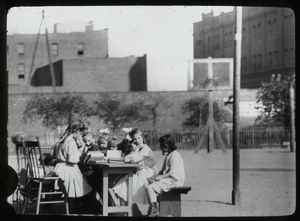 Corlear's Hook Park : girls around table in park, ca. 1910s
