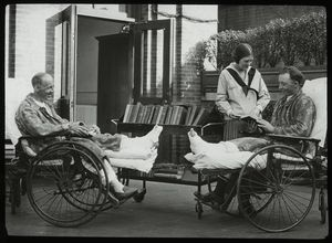 Post Graduate Hospital : convalescents and librarian on sun porch, 1923.