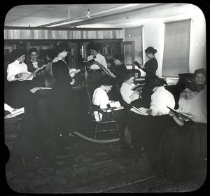 Women reading, April 30, 1910, Siegel-Cooper Company.