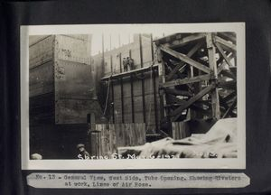 General view, West  side, tube opening. Showing riveters at work, lines of air hose. Spring Street, May 6, 1921.