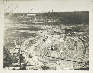 Kensico reservoir. View showing excavation for foundation of Kensico dam in progress. Note wooden flume for controlling water of Bronx river. Contract 9. July 30, 1912.