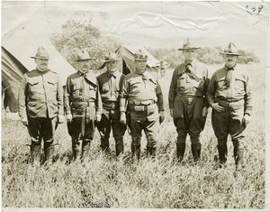 Officers of the 69th Regiment, New York National Guard. From left to right: Major Michael Lynch, Captain  Felix McSherry, Captain Bernard F. Cummings, Captain E. M. Dillon, Chaplain Francis P. Duffy and Captain B. J. Glynn.
