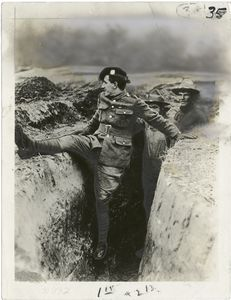 A Scotch sergeant showing American troops how to charge over the top of a trench.