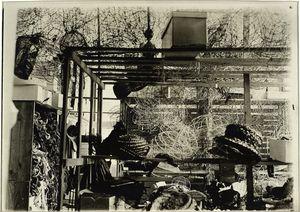 [Storage room, showing braided straw, hat forms, wire...]