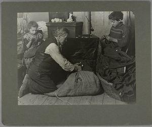 Mr. Vianna, Josephine, 9... Nicholas, 12, are working on garments, January 1908