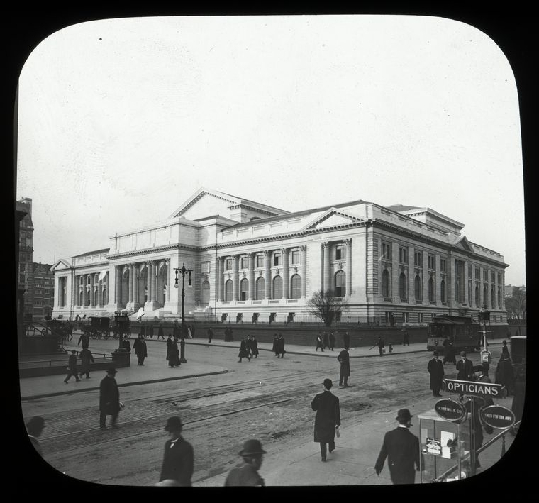 Central building, exterior views, Fifth Avenue : Fifth Avenue and 42nd street, looking southwest at street level, pedestrians, trolley, ca. 1911.