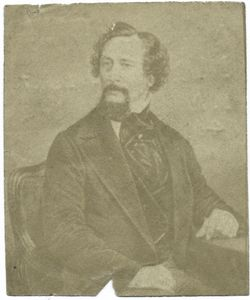 [Charles Dickens (seated).]