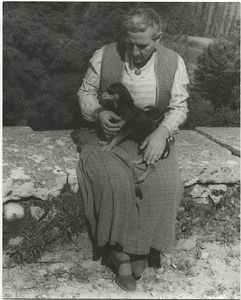Gertrude Stein, with Pepe on the Terrace of the Villa at Bilignin, June 13, 1934.