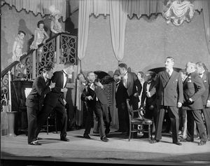 Scene from 'Broadway' NYC: Broadhurst Theatre, 1926, with Lee Tracy, Millard Mitchell, Robert Gleckler, et al.