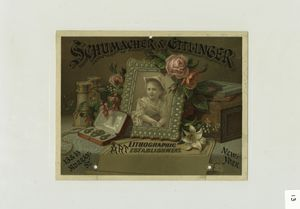 [A trade card with the text : Schumacher & Ettlinger art lithographment, 13 & 15 Murray St., New York; depicting a table spread with binoculars, a picture of a girl in a frame, jewelry, flowers, boxes and books.]