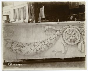 [Plaster model of architectural decorations, and a model of the Fifth Avenue facade in the background.]