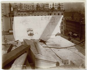 [Exterior marble work : a piece of marble in position on the roof, looking north.]