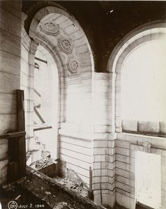 [Interior work : decorated arch above the initial construction of a staircase.]
