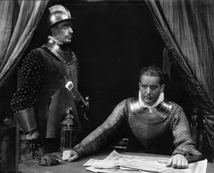 """Alfred Lunt (seated) as Earl of Essex in """"Elizabeth the Queen"""", NYC, 1930."""